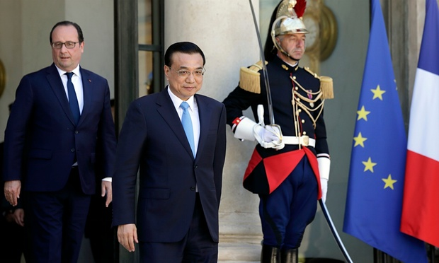 French President Francois Hollande (L) looks at Chinese Premier Li Keqiang leaving after a meeting at the Elysee Palace in Paris, France. Photograph: Philippe Wojazer/Reuters